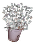 Dollars flying out of old bucket Royalty Free Stock Photo