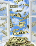 Dollars flying out from opened window Royalty Free Stock Photos