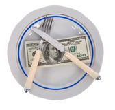 Dollars on food plate Stock Images