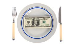 Dollars on food plate Stock Photos