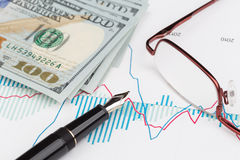 Dollars and fountain pen Stock Image