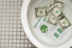 Dollars getting ready to be flushed down the toile Stock Photography