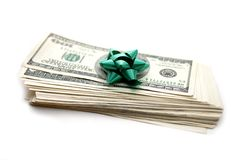 Dollars with gift bow Royalty Free Stock Image