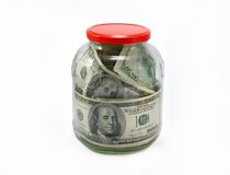 Dollars in a glass jar Stock Images