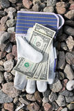 Dollars and gloves royalty free stock image