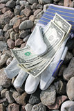 Dollars and gloves royalty free stock photos