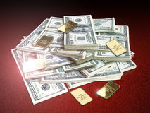 Dollars and gold Stock Images
