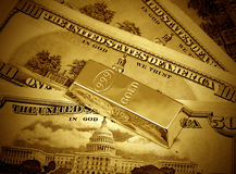 Dollars and gold bullion stock image