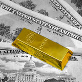 Dollars and gold bullion. The money american dollars and gold bullion , black and white photo and golden color Stock Photos