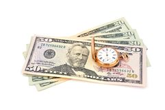 Dollars and  gold watch Stock Photo
