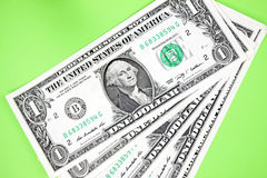 Dollars on green backgroudn. Royalty Free Stock Photography