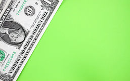 Dollars on green backgroudn. Stock Photos
