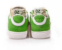 Dollars in green shoes Stock Photography