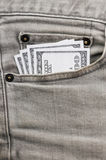 Dollars in grey jean pocket Royalty Free Stock Images