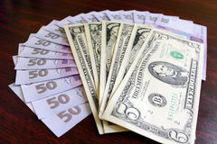 Dollars and grivnas banknotes on the dark Royalty Free Stock Photography