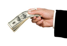 Dollars in hand Stock Images