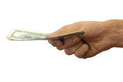 Dollars in hand. Pack of dollars in the men's hand. Isolated on white royalty free stock images