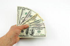 Dollars in a hand. Dollars in a man's hand on a white background Royalty Free Stock Images