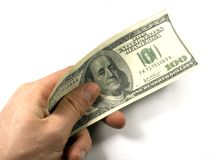 Dollars in hand. White background Royalty Free Stock Images