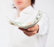 Dollars in hand Stock Photo