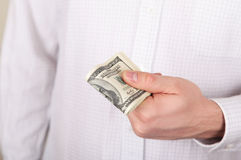 Dollars in a hand Royalty Free Stock Photography