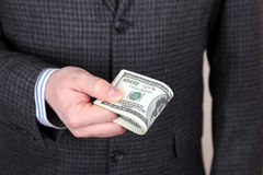 Dollars in a hand Stock Photography