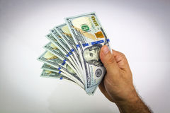 Dollars in hand Stock Photos