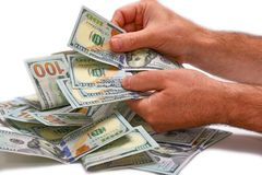 Dollars in hand, calculation Stock Photos