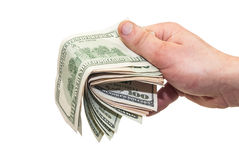 Dollars in the hand. Cash US dollars in male hand Royalty Free Stock Photo