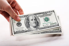 Dollars in hand, close up Royalty Free Stock Photos