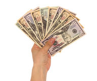 Dollars in hand. A lot of dollars on a white background isolated Royalty Free Stock Images