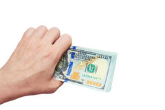 Dollars in a hand on a white background Royalty Free Stock Photo