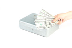 Dollars in a hand on white. Dollars in a hand with silver money box on white background Stock Photos