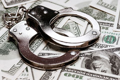 Dollars and handcuffs. Handcuffs on money background as security concept Royalty Free Stock Photography
