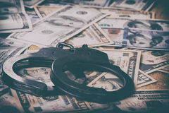Dollars and handcuffs. Financial crime, illegal activity stock photography