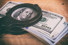 Dollars and handcuffs. Financial crime, illegal activity stock photo