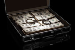 Dollars and handcuffs in suitcase isolated on black Royalty Free Stock Photo