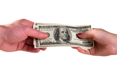 Dollars in hands. Man's and female hands hold dollars, is isolated a white background Royalty Free Stock Image