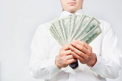 Dollars in hands Stock Images