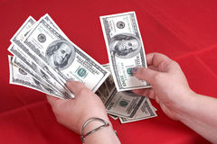 Dollars and hands Stock Photos
