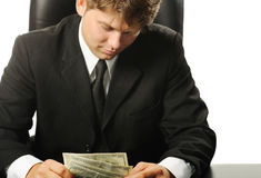 Dollars in a hands of the businessman Stock Images