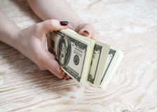 Dollars in hands Stock Photos