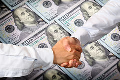 Dollars Handshake Royalty Free Stock Images