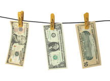 Dollars hang on clothes-peg. On white background Royalty Free Stock Photography