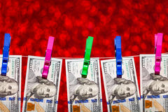 Dollars hang on rope attached with clothes pins Royalty Free Stock Photography