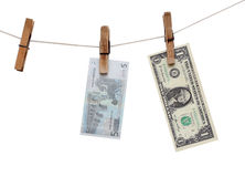 Dollars hang on the rope on the clothespin Stock Image