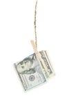 Dollars hang on rope Stock Photo