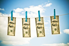 Dollars hanging Stock Photos