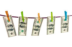 Dollars hanging on color clothespins isolated Royalty Free Stock Images