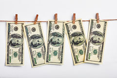 Dollars hanging on a rope. Royalty Free Stock Photo